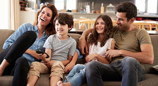 Family watching movie in TVTap Pro APK